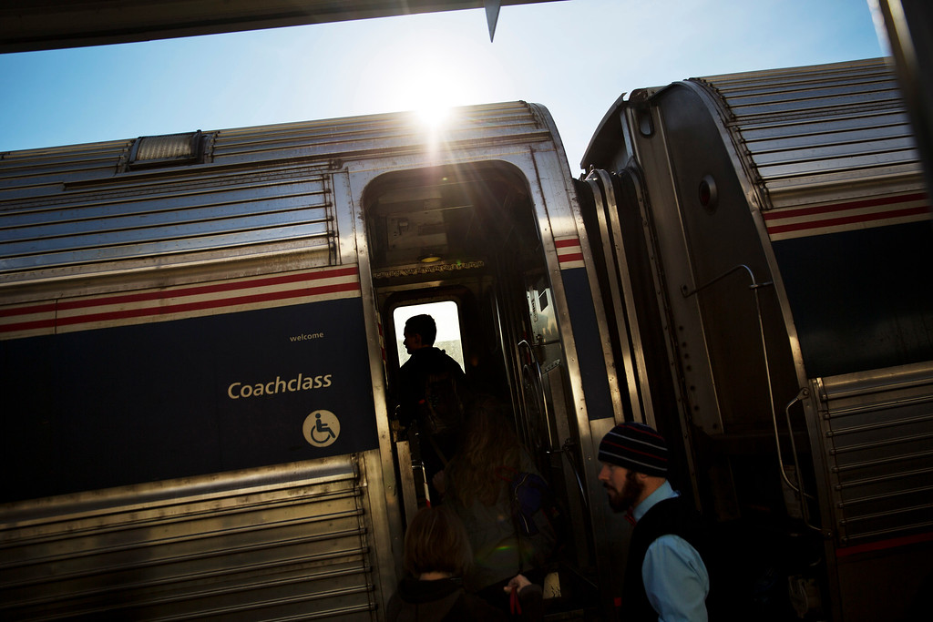 . Passengers board an Amtrak train heading to New Orleans in Atlanta, Wednesday, Nov. 23, 2016. Almost 49 million people are expected to travel 50 miles or more for the Thanksgiving holiday, the most since 2007, according to AAA. (AP Photo/David Goldman)