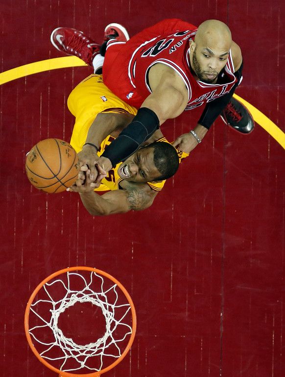 . Cleveland Cavaliers\' James Jones, bottom, blocks a shot by Chicago Bulls\' Taj Gibson during the second half of Game 2 in a second-round NBA basketball playoff series Wednesday, May 6, 2015, in Cleveland. The Cavaliers defeated the Bulls 106-91. (AP Photo/Tony Dejak)
