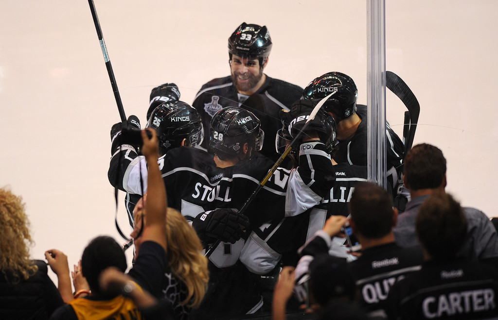 . The Kings\' Jarret Stoll is congratulated by teammates after his second-period goal against the Rangers in game two of the Stanley Cup Final, Saturday, June 7, 2014, at Staples Center. (Photo by Michael Owen Baker/Los Angeles Daily News)