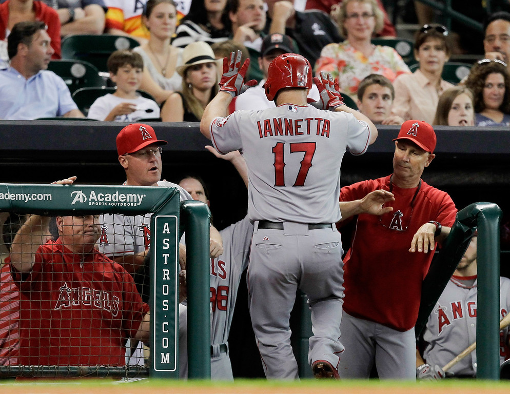 . HOUSTON, TX - SEPTEMBER 14:  Chris Iannetta #17 of the Los Angeles Angels of Anaheim receives high-fives from the bench after hitting a home run in the third inning against the Houston Astros at Minute Maid Park on September 14, 2013 in Houston, Texas.  (Photo by Bob Levey/Getty Images)
