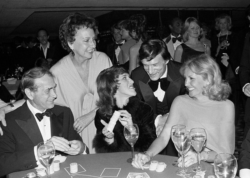 . Actress Jean Stapleton, top left, and publisher Hugh Hefner laugh with, from foreground left, Darren McGavin, Ruth Buzzi and Barbara Fisher, during a black-tie casino fund raiser in Los Angeles on Monday, March 13, 1979. Stapleton has died at the age of 90. John Putch said Saturday, June 1, 2013 that his mother died Friday, May 31, 2013 of natural causes at her New York City home surrounded by friends and family. (AP Photo/Lennox McLendon)