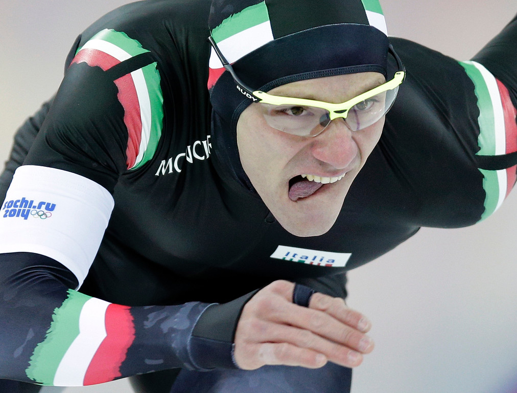 . Mirko Nenzi of Italy competes in the first heat of the men\'s 500-meter speedskating race at the Adler Arena Skating Center during the 2014 Winter Olympics, Monday, Feb. 10, 2014, in Sochi, Russia.  (AP Photo/Pavel Golovkin)