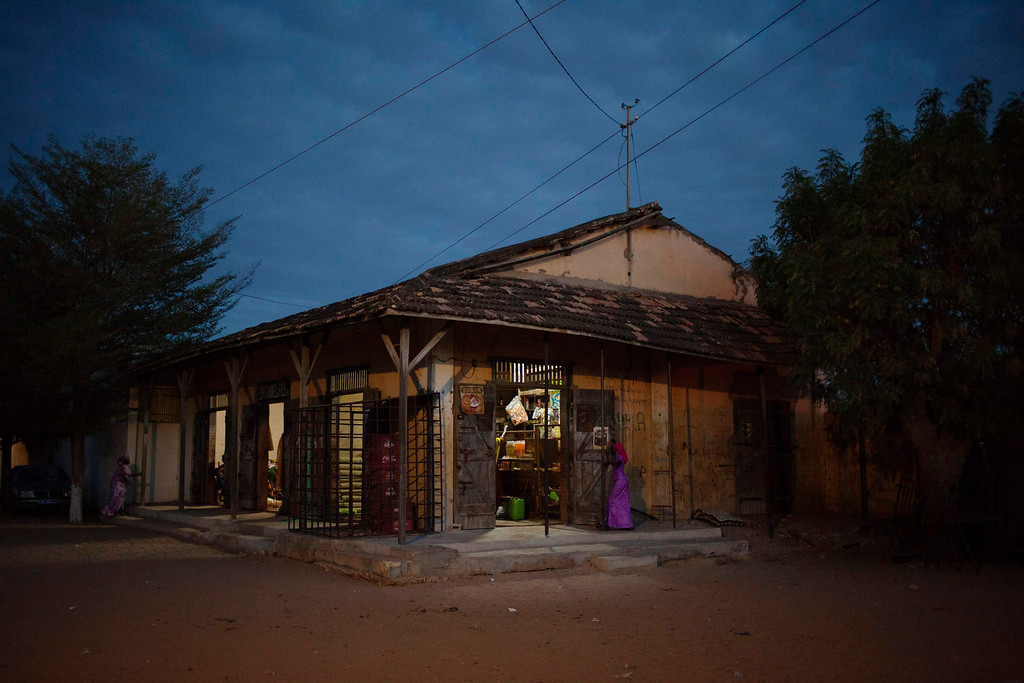 . A convenience store housed in a colonial-era building is seen in the village of Ndande May 18, 2013. Every year, inhabitants of the village take part in a Sufi Muslim ceremony called Gamou-Ndande. The ceremony combines nights of praying and chanting as well as traditionally animist ceremonies. Picture taken May 18, 2013. REUTERS/Joe Penney