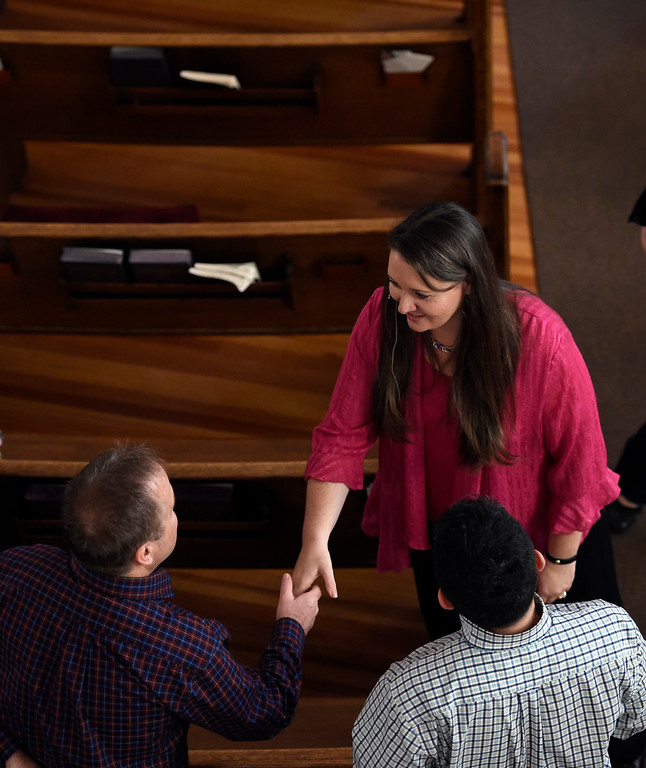 . DENVER, CO - APRIL 10: Rev. Jessica Rooks meets with Jeff Wallick (L) and Derek Camunez April 10, 2016 during the 11am worship at St. Paul\'s Methodist Church. St. Paul\'s Methodist Churcha a 156-year-old church in an iconic neoclassical building in Uptown, is closing its doors. The congregation make prayer flags during Sunday worship that will be hung along others that have been hung already through out the Church. (Photo By John Leyba/The Denver Post)