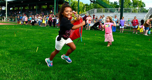 8/22/2019 Mike Orazzi | Staff Alanna Alleyne,4, runs while looking for blue pencils during the second annual Mayors Back to School Pencil Hunt held at Muzzy Field in Bristol on Thursday evening.