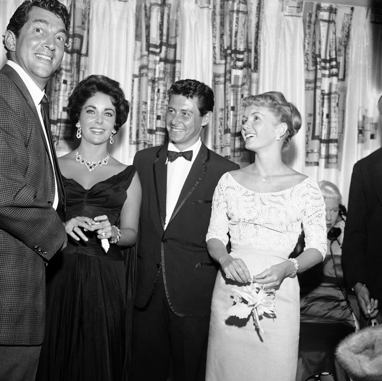 . Dean Martin, Elizabeth Taylor, Eddie Fisher and Debbie Reynolds, from left to right, are shown attending the opening show starring Fisher at the Tropicana, June 19, 1958, Las Vegas, Nev. (AP Photo)