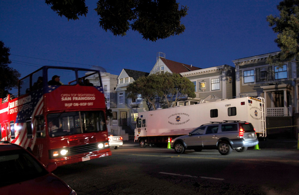 . A tourist buses passes by a San Francisco Police mobile command vehicle parked in front of a home on the 1100 block of Masonic Avenue in San Franciso Tuesday Jan. 29, 2013 where a search was reportedly taking place for evidence in the disappearance of 10-year-old Kevin Collins 29 years ago.  (Karl Mondon/Staff)