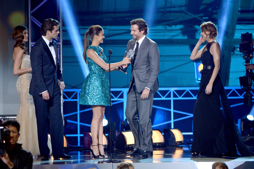 ". (L-R) Actors Henry Cavill and Nina Dobrev present actors Bradley Cooper and Jennifer Lawrence the Best Acting Ensemble Award for ""Silver Linings Playbook\"" onstage at the 18th Annual Critics\' Choice Movie Awards held at Barker Hangar on January 10, 2013 in Santa Monica, California.  (Photo by Kevin Winter/Getty Images)"