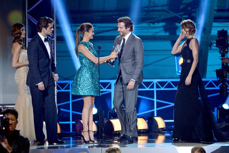 """. (L-R) Actors Henry Cavill and Nina Dobrev present actors Bradley Cooper and Jennifer Lawrence the Best Acting Ensemble Award for \""""Silver Linings Playbook\"""" onstage at the 18th Annual Critics\' Choice Movie Awards held at Barker Hangar on January 10, 2013 in Santa Monica, California.  (Photo by Kevin Winter/Getty Images)"""