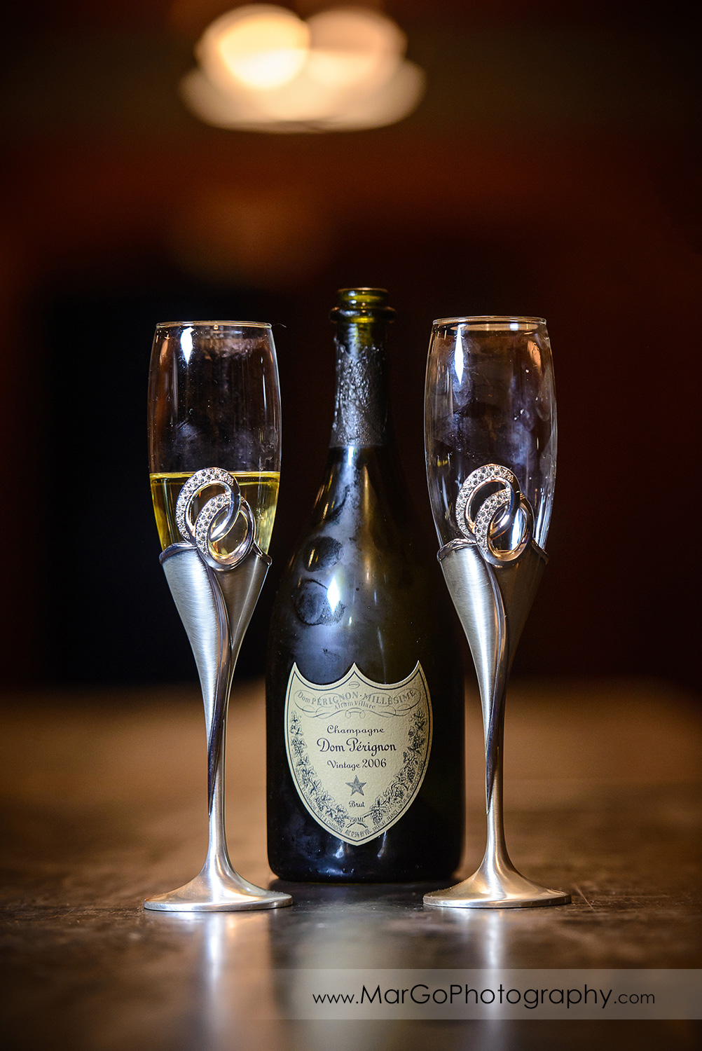 dom perignon and bride and groom's champagne galsses during wedding reception at Saratoga Foothill Club