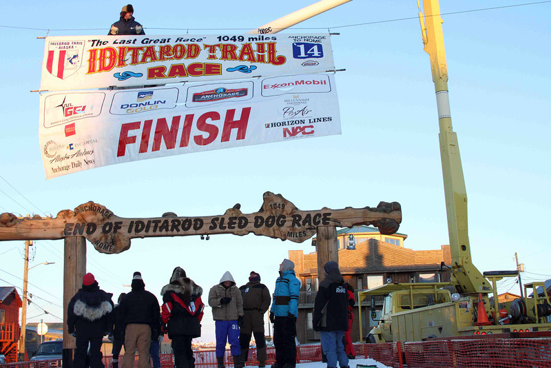 . The Iditarod Trial Sled Dog Race finish banner is raised above the burled arch finish line in Nome, Alaska, on Monday, March 10, 2014. The race winner is expected some time early Tuesday, March 11, 2014. (AP Photo/Mark Thiessen)