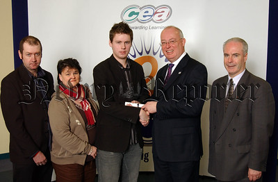 Christopher Woods, a past pupil of Abbey Christian Brothers Grammar School accepts a certificate from CCEA's Chief Executive Gavin Boyd to mark his achievement of overall first place in Government & Politics in CCEA's summer 2006 A level examinations.  Also pictured are Christopher's parents and principal, Mr McGovern.