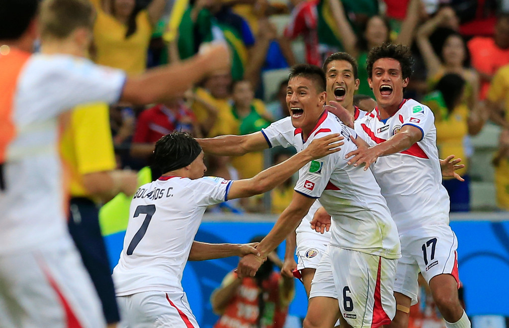 . Costa Rica\'s Oscar Duarte, center, celebrates after scoring his side\'s second goal during the group D World Cup soccer match between Uruguay and Costa Rica at the Arena Castelao in Fortaleza, Brazil, Saturday, June 14, 2014.   (AP Photo/Bernat Armangue)