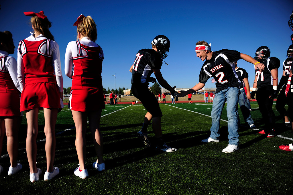 . Cheyenne Central\'s Greg Ashley (left) is high fived by teammate Rhett Muchmore before playing Cheyenne East. East won 42-28 at Central\'s Riske Field on Friday, September 14, 2012. AAron Ontiveroz, The Denver Post