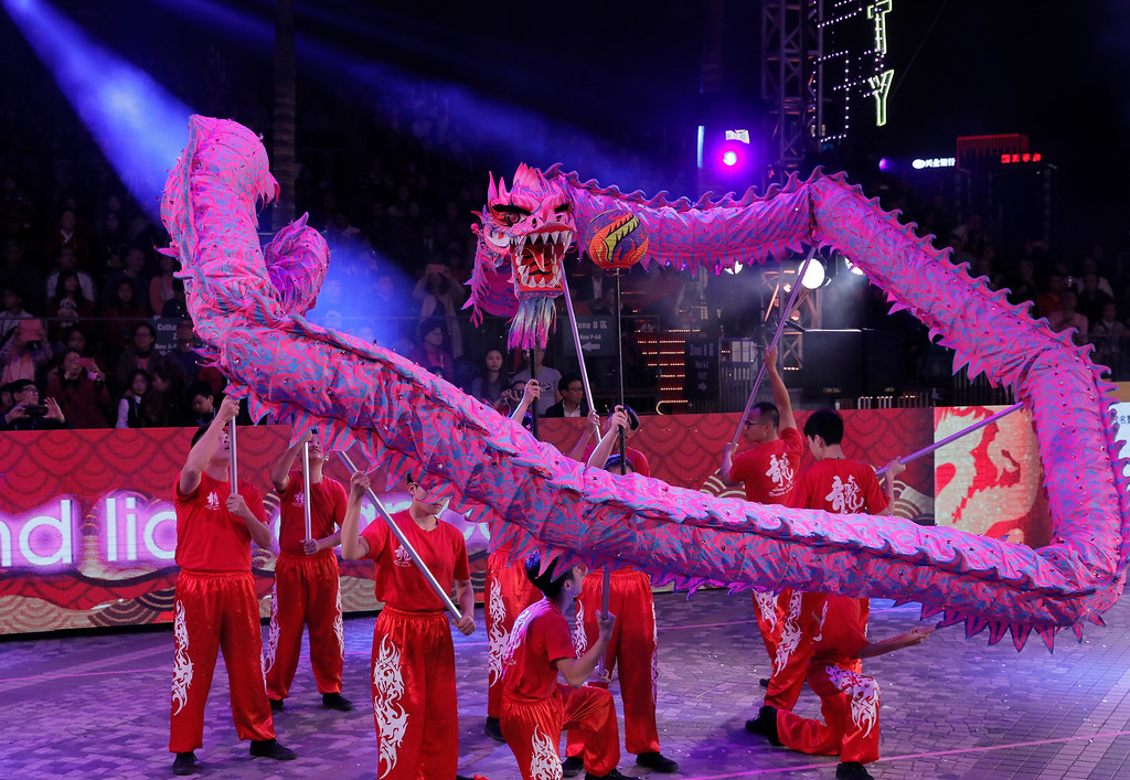 . Dragon dance take part in a night parade to celebrate Chinese New Year in Hong Kong Friday, Feb. 16, 2018. The Lunar New Year this year marks the Year of the Dog in the Chinese calendar. (AP Photo/Vincent Yu)
