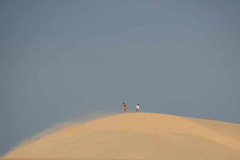 Wind blowing at the white sand dunes - Mui Ne, Vietnam