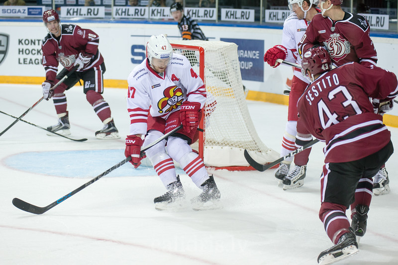 Ville Lajunen (47) block the shot of Tim Sestito (43) in the KHL regular championship game between Dinamo Riga and Jokerit, played on September 13, 2016 in Arena Riga