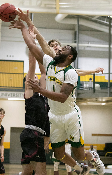 Fitchburg State University played Massachusetts Institute of Technology on Saturday, Dec. 7, 2019 at FSU's Recreation Center. FSU's #1 Charles Doss tries to get a shot off. SENTINEL & ENTERPRISE/JOHN LOVE