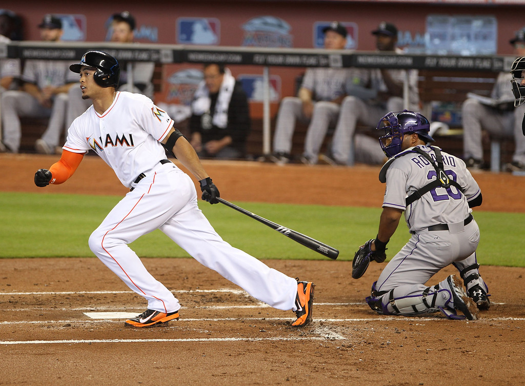 . Giancarlo Stanton #27 of the Miami Marlins gets a hit against the Colorado Rockies during the first inning at Marlins Park on April 3, 2014 in Miami, Florida.  (Photo by Marc Serota/Getty Images)