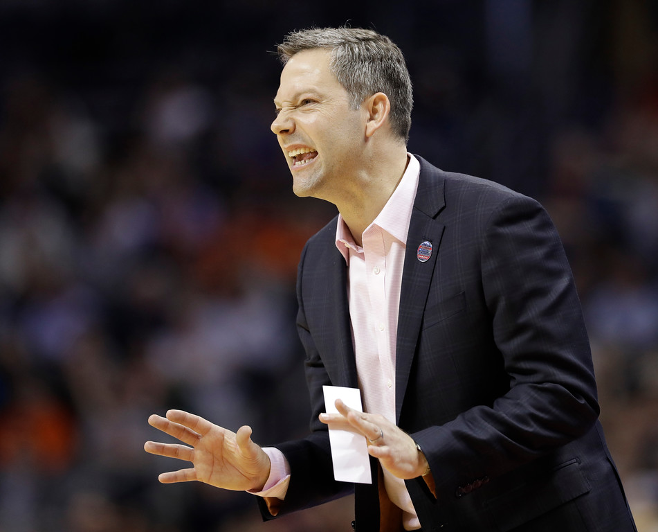 . UMBC head coach Ryan Odom directs his team against Virginia during the first half of a first-round game in the NCAA men\'s college basketball tournament in Charlotte, N.C., Friday, March 16, 2018. (AP Photo/Gerry Broome)