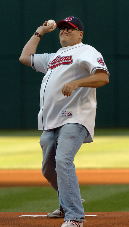. Actor Drew Carey throws out the ceremonial first pitch Saturday, Aug. 12, 2006, before the Cleveland Indians\' baseball game against the Kansas City Royals in Cleveland. (AP Photo/Jeff Glidden)