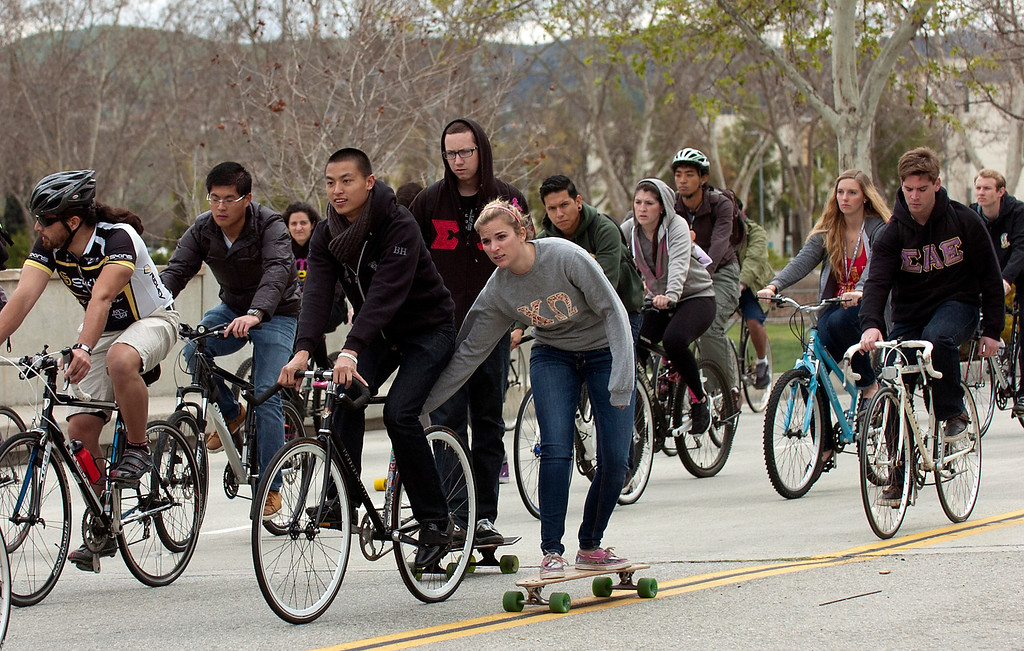". ON08-BIKERIDE-02-JCM (Jennifer Cappuccio Maher/Staff Photographer) Students take a memorial bike ride as friends and family gather to remember Cal Poly student Ivan Arturo Aguilar Thursday, March 7, 2013, at Cal Poly Pomona in Pomona. A ""ghost bike\"" was installed and a memorial bike ride was held in his memory. Aguilar was killed after he was hit by a car while riding his bike on campus last week."
