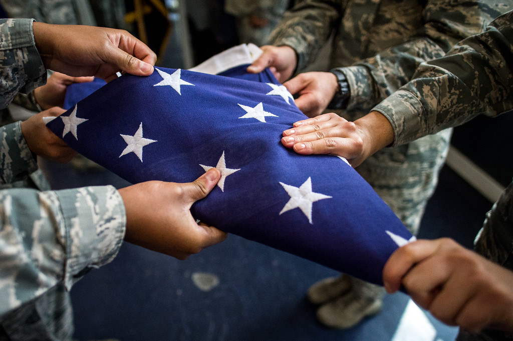 . Members of the Blue Eagles Honor Guard practice folding the U.S. flag during a training at March Air Reserve Base in Riverside, Calif. on Tuesday, May 12, 2015. (Photo by Watchara Phomicinda/ Los Angeles Daily News)