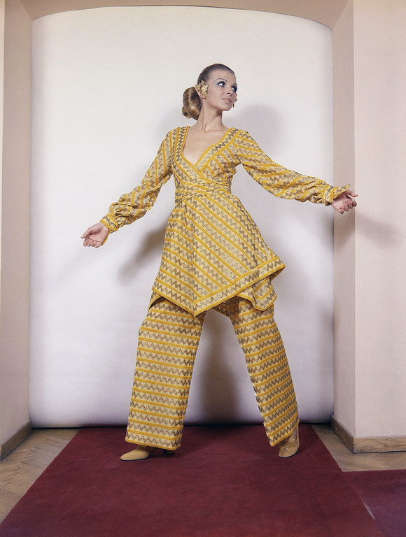 . A cassock and pant dress of yellow chiffon worked with velvet and gold, a creation by the Renato Balestra fashion house of Rome, presented at the Italian fall and winter fashion shows that opened in Rome. Undated photo. (AP Photo)