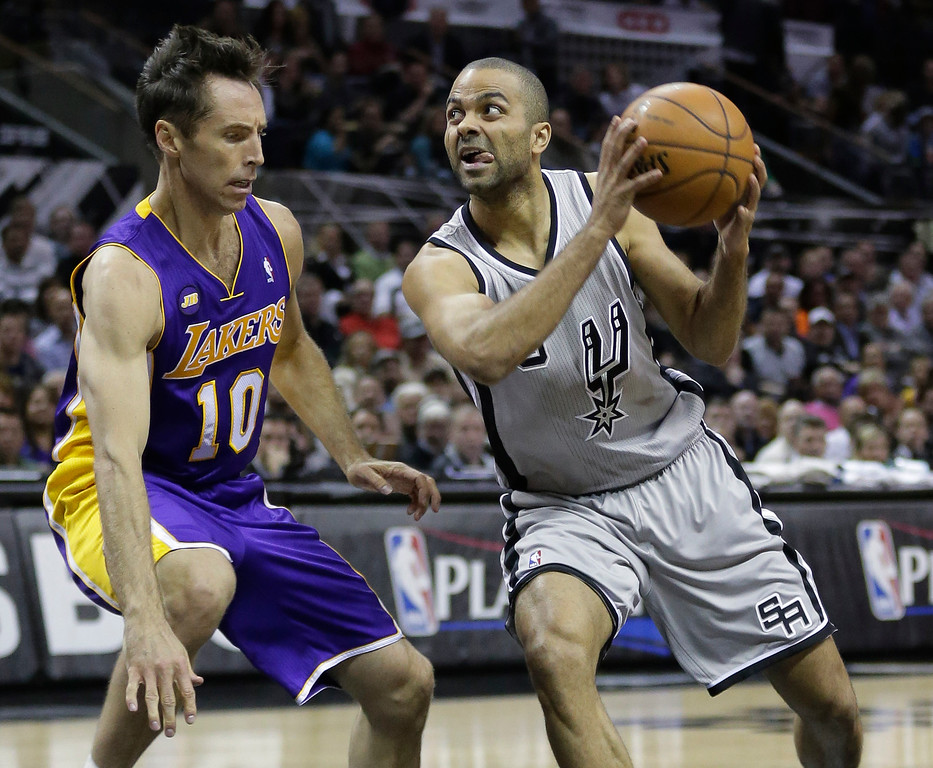 . San Antonio Spurs\' Tony Parker, right, of France, drives as Los Angeles Lakers\' Steve Nash (10) defends during the first half of Game 2 of a first-round NBA basketball playoff series on Wednesday, April 24, 2013, in San Antonio, Texas. (AP Photo/Eric Gay)