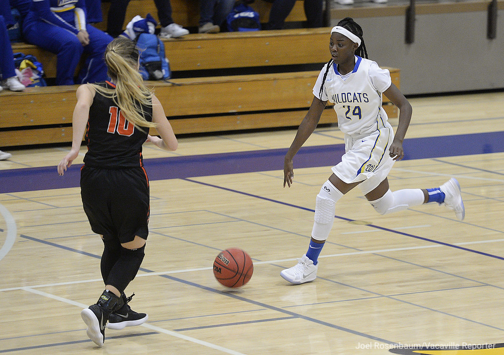 . Will C. Wood\'s Jaelyn Lockhart leads the fast break during the second quarter.