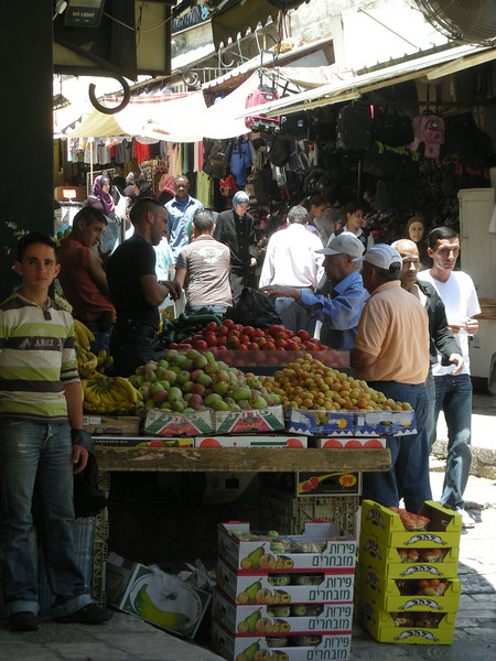 a fruit seller's stand inside from the Damascus Gate, the old city of Jerusalem.