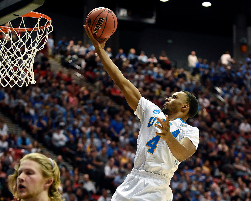. UCLA guard Norman Powell (4) sails to the basket against Stephen F. Austin in a third-round game in the NCAA college basketball tournament, Sunday, March 23, 2014, in San Diego. (AP Photo/Denis Poroy)