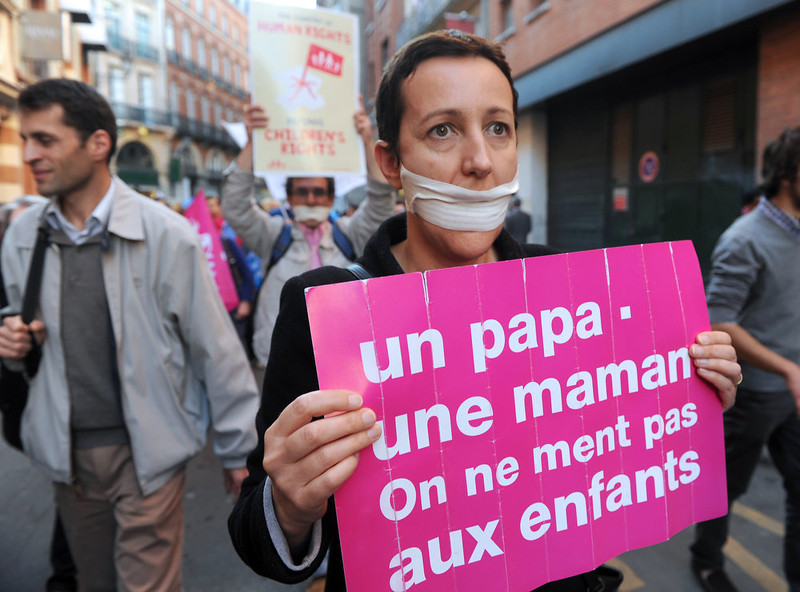 """. Supporters of the anti-gay marriage movement \""""La Manif Pour Tous\"""" (Demonstration for all!) demonstrate  on April 23, 2013 in Toulouse after the French national assembly adopted a bill legalizing same-sex marriages and adoption for gay couples, defying months of opposition protests. In its second and final reading, a majority of lawmakers approved the bill by a vote of 331 to 225. ( placard reads: One Father. One mother. We don\'t lie to children) ERIC CABANIS/AFP/Getty Images"""