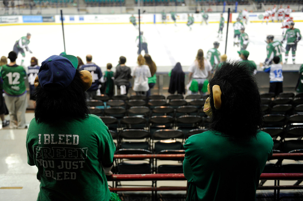 . DENVER, CO - MAY 2: A pair of fans dressed as monkeys watch the Denver Cutthroats and Allen Americans warmup before the first period of game 1 of the Ray Miron Presidents Cup Finals at the Denver Coliseum in Denver, Colorado on May 2, 2014. (Photo by Seth McConnell/The Denver Post)