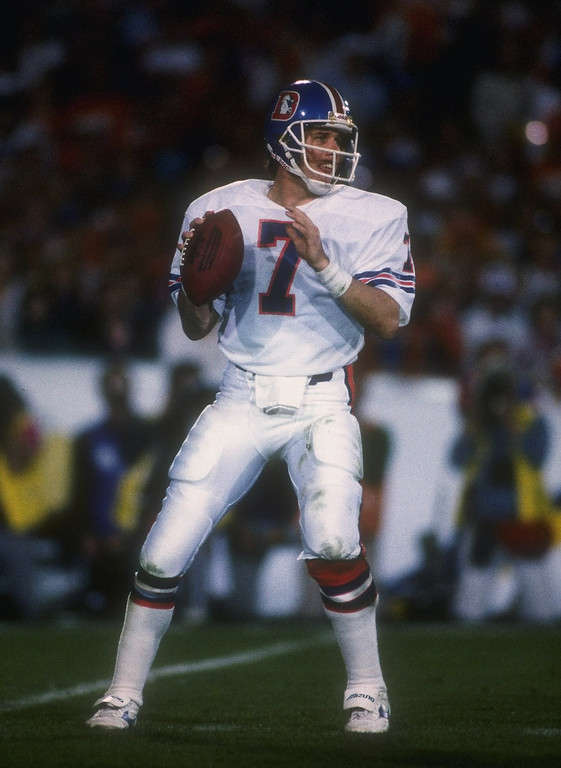 . Quarterback John Elway of the Denver Broncos looks to pass the ball during Super Bowl XXI against the New York Giants at the Rose Bowl in Pasadena, California. The Giants won the game, 20-19. (Denver Post Archive)