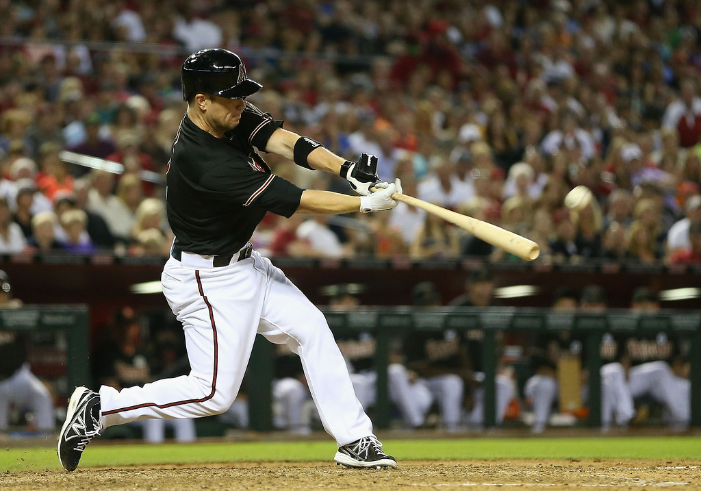 . PHOENIX, AZ - JULY 05:  Aaron Hill #2 of the Arizona Diamondbacks hits a RBI single against the Colorado Rockies during the seventh inning of the MLB game at Chase Field on July 5, 2013 in Phoenix, Arizona.  (Photo by Christian Petersen/Getty Images)