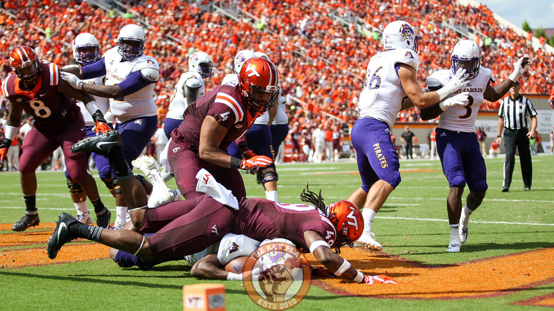 Tremain Edmunds (49) lays on top of ECU WR James Summers after forcing him to the turf for a safety. (Mark Umansky/TheKeyPlay.com)