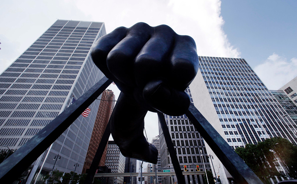 """. The Detroit skyline rises behind the Monument to Joe Louis, also known as \""""The Fist,\"""" Thursday, July 18, 2013. State-appointed emergency manager Kevyn Orr asked a federal judge permission to place Detroit into Chapter 9 bankruptcy protection. (AP Photo/Paul Sancya)"""