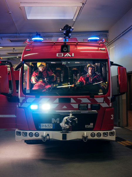 Alex Paonna (left) and Rudy Fassin (right), direct response crew (professional firefighters) inside a Proteus truck, in the firefighter hangar on the French side - Samuel Zeller for the New York Times