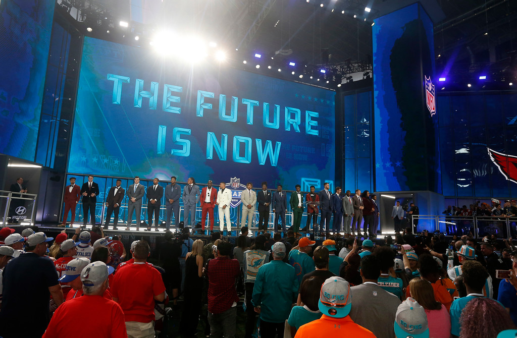 . Prospects in attendance stand on stage at the start of the first round of the NFL football draft, Thursday, April 26, 2018, in Arlington, Texas. (AP Photo/Michael Ainsworth)