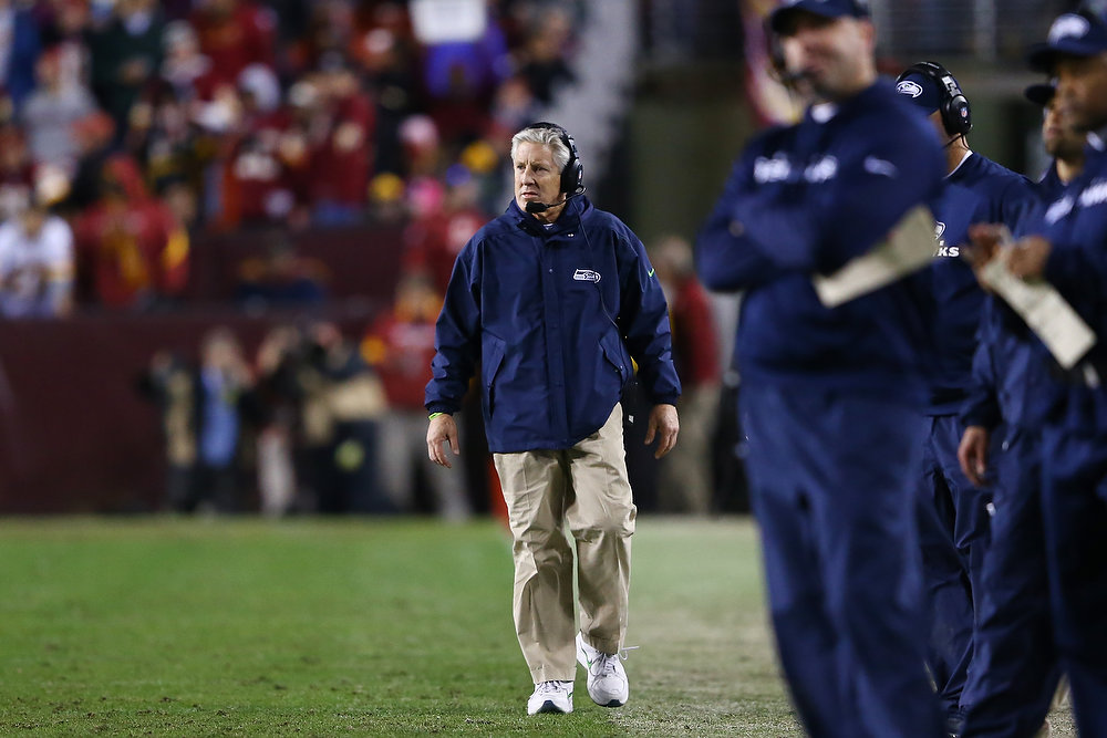 . Head coach Pete Carroll of the Seattle Seahawks looks on during the third quarter against the Washington Redskins during the NFC Wild Card Playoff Game at FedExField on January 6, 2013 in Landover, Maryland.  (Photo by Al Bello/Getty Images)