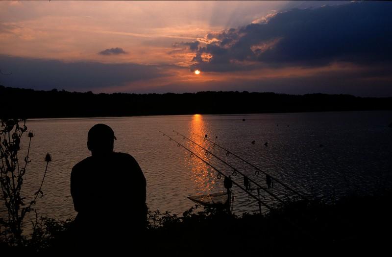 WCC03-benslides27 - Angler sat by rods at sunset