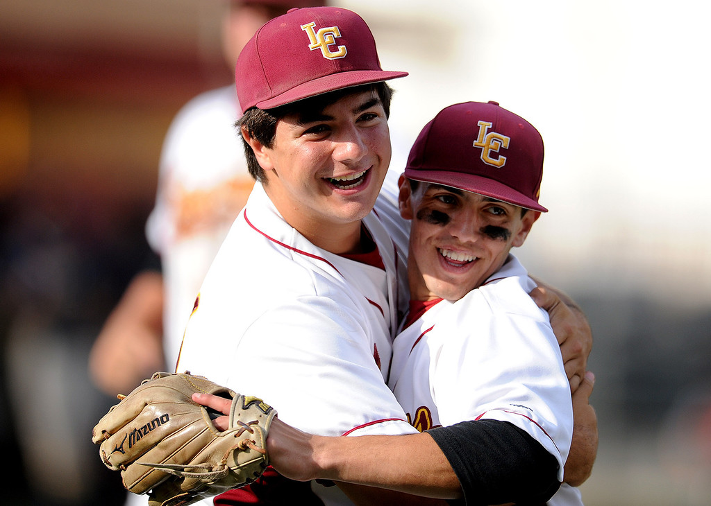 . La Canada\'s Clayton Herrmann, right, hugs teammate Daniel del Valle after defeating California 4-2 during a CIF-SS playoff baseball game at La Canada High School on Thursday, May 16, 2013 in La Canada, Calif.  (Keith Birmingham Pasadena Star-News)