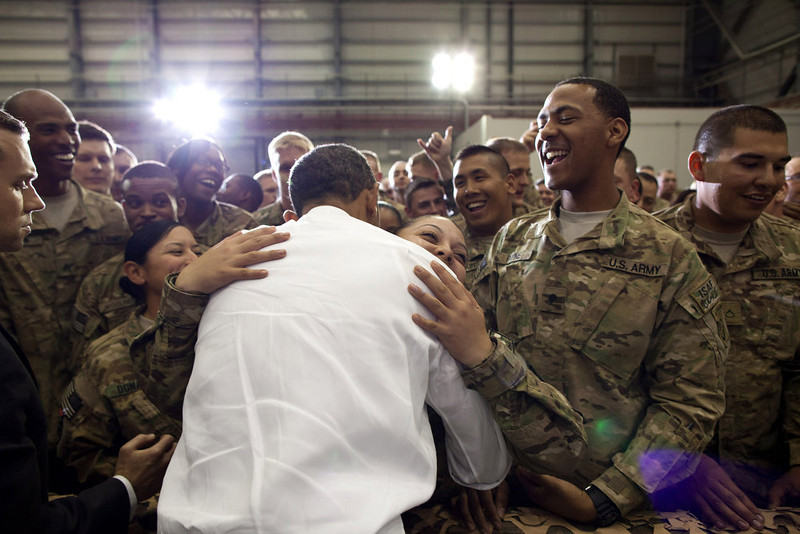 ". May 1, 2012 ""A soldier hugs the President as he greeted U.S. troops at Bagram Air Field in Afghanistan.\"" (Official White House Photo by Pete Souza)"