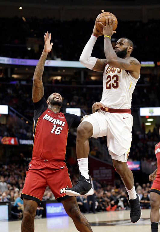 . Cleveland Cavaliers\' LeBron James (23) drives to the basket against Miami Heat\'s James Johnson (16) in the first half of an NBA basketball game, Tuesday, Nov. 28, 2017, in Cleveland. (AP Photo/Tony Dejak)