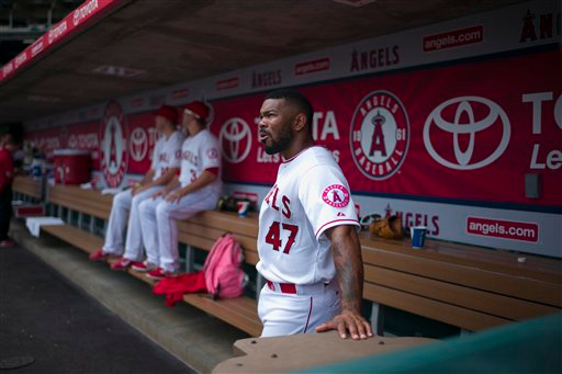. Los Angeles Angels\' Howie Kendrick stands in the dugout before a baseball game against the Detroit Tigers on Sunday, July 27, 2014, in Anaheim, Calif. The Angels won 2-1. (AP Photo/Jae C. Hong)