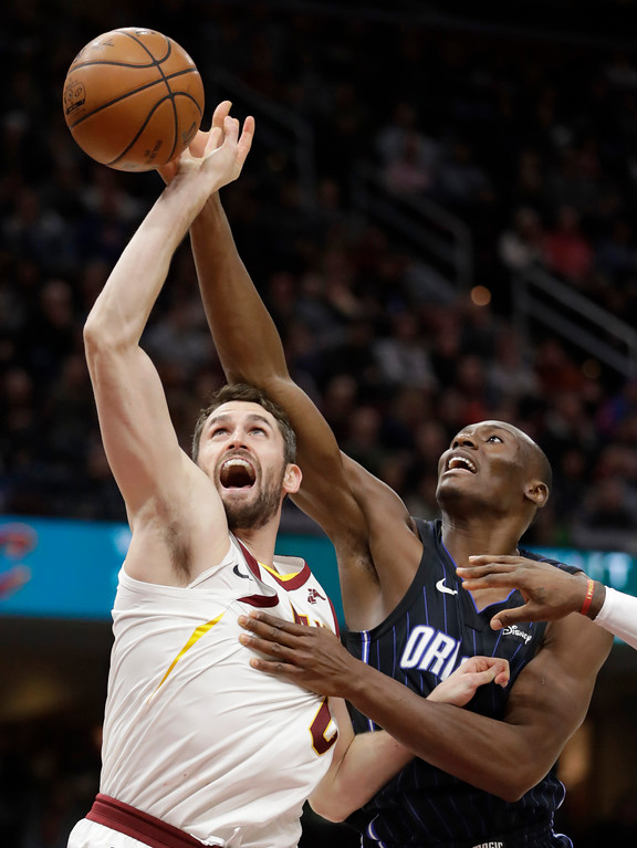 . Orlando Magic\'s Bismack Biyombo, right, fouls Cleveland Cavaliers\' Kevin Love during the second half of an NBA basketball game Thursday, Jan. 18, 2018, in Cleveland. The Cavaliers won 104-103. (AP Photo/Tony Dejak)