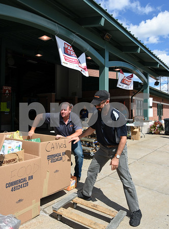 09/08/17 Wesley Bunnell | Staff A Pack the Truck event for Hurricane Harvey relief took place on Friday afternoon in the parking lot at New Britain Stadium. The event was a partnership between the New Britain Bees, Houston Astros outfielder George Springer, Siracusa Moving and Storage, A1 Automotive Repair, the Connecticut Blue Jays AAU Travel Team and Premier Limousine with trucks from Siracusa leaving for Houston following the event. Bob Wells, L, and Matt Siracusa, L, both from Siracusa Moving and Storage, help prepare donations boxes to be moved.