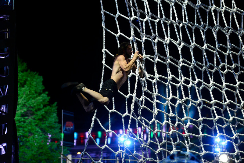 . Isaac Caldiero (dressed as Jesus Christ) jumps onto the cargo net during his tryout for American Ninja Warrior Denver. Caldiero dominated the course. (Photo by AAron Ontiveroz/The Denver Post)