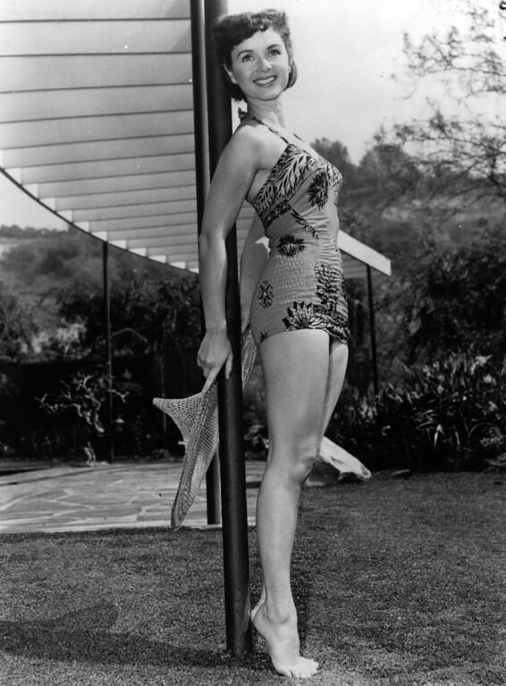 . American actress, Debbie Reynolds modelling a swimsuit in the garden.    (Photo by Keystone/Getty Images)